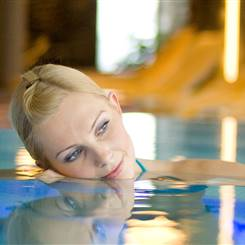 Woman in close up in a pool in a SPA area