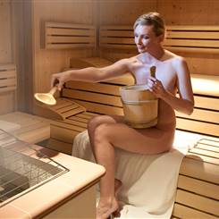 Woman in sauna makes an infusion
